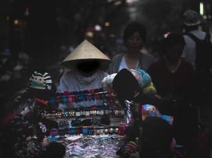 Street Photography shadow vendor in Hanoi, Vietnam