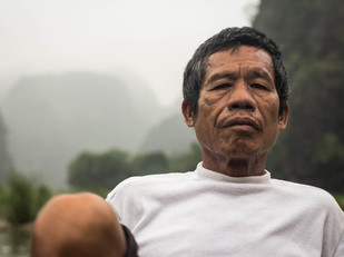 portrait of vietnamese man foot rowing in Tam Coc