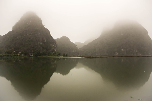 Nature photography of mountains and mist in Tam Coc, Vietnam
