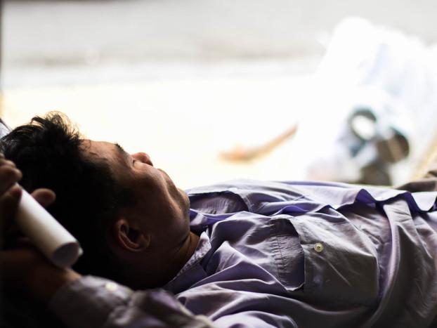 Street Photography Vietnamese man sleeps in Hanoi