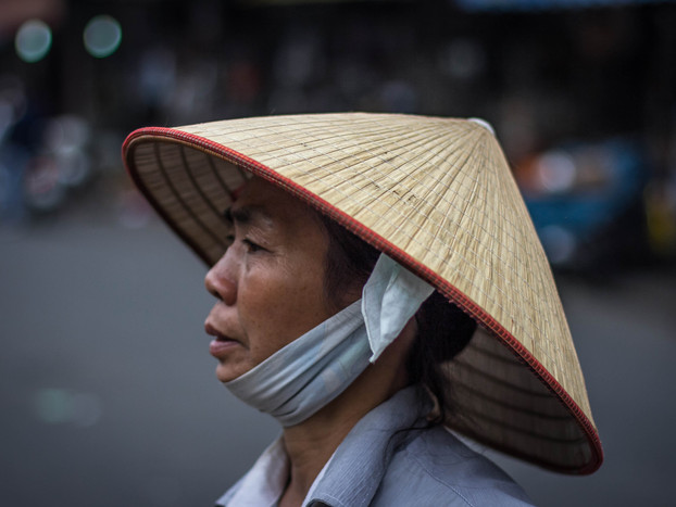street photography Vietnamese woman wearing asian conical hat