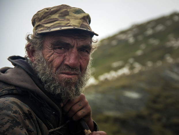 Travel photography portrait of Georgian sheepherder in Caucasus Mountains