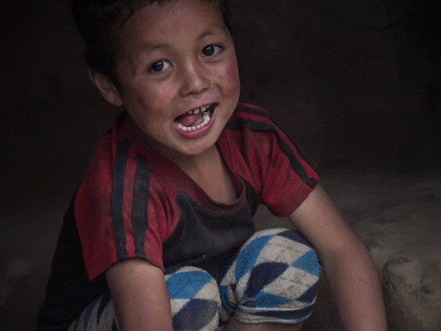 Travel Photography Nepali boy kneads dough