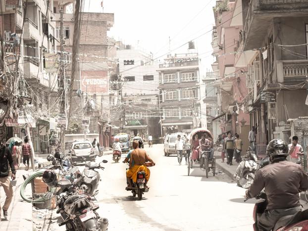 Street Photography of Buddhist on a Motorbike in Kathmandu