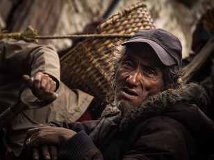 Travel Photography Nepali Worker in Upper Pisang