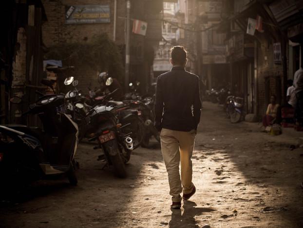 Street Photography Nepali man walking in Thamel, Kathmandu