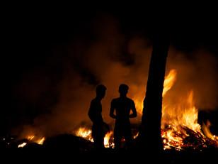 Documentary photography men burning waste in India