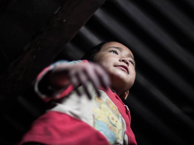 travel photography little boy in Laos Akha village