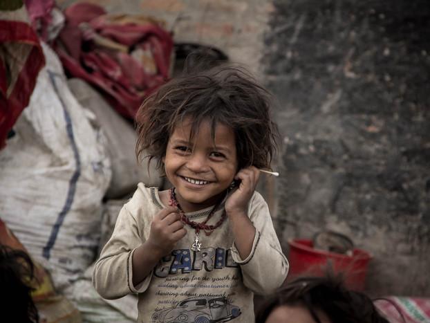 Street photography of poor Nepali boy in Kathmandu