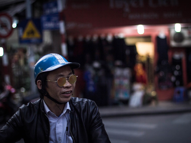 street photography Vietnamese man on motorbike