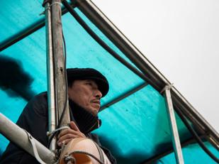 travel photography Vietnamese man on boat
