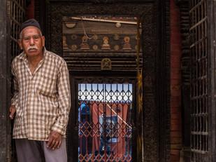 street photography Nepali man outside Hindu temple in Kathmandu