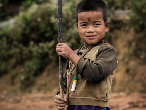 Travel Photography Akha village boy in Laos