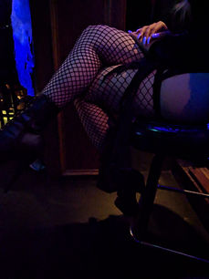 dancers legs sitting on a bar stool