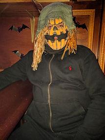 man in a pumpkin costume
