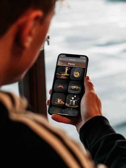 Man Holding iPhone Mockup 2.jpg