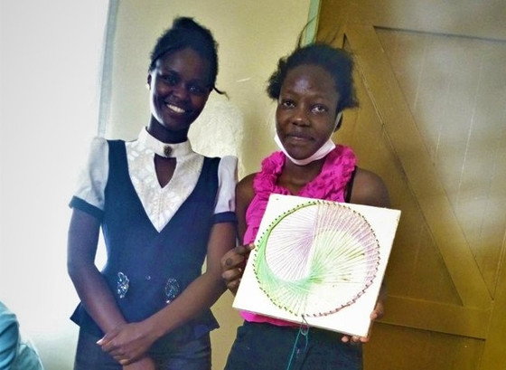 String art with a talk on business skills with Artist Elizabeth Kambi of Nyatero Art!