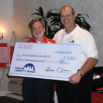 Donation being made to Archbishop John Carroll High School by Brian Zwaan donation charity