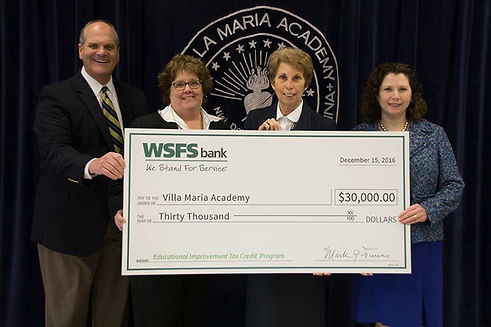 Donation being made to Villa Maria Academy Brian Zwaan check charity