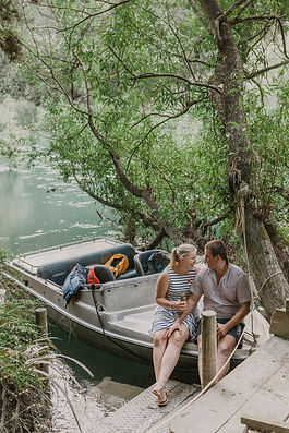 Couple-Sitting-on-their-jet-boat-New-Zeland