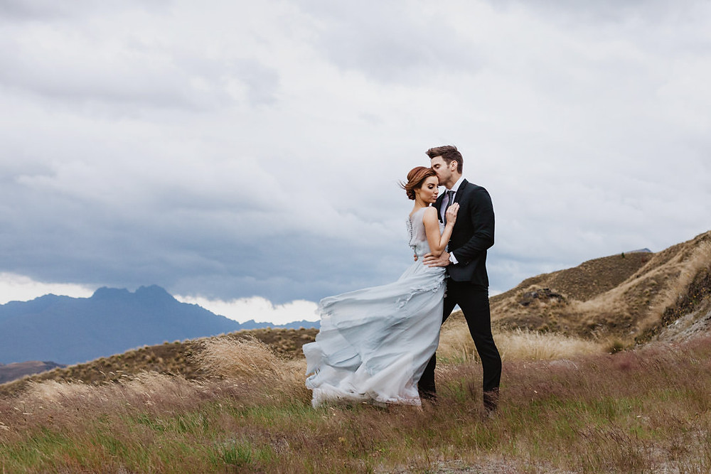 Queenstown sunrise engagement photos up a mountain