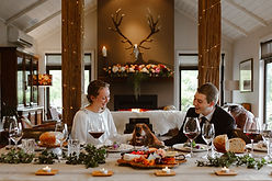Bride and Groom wit dog having an intimate dinner