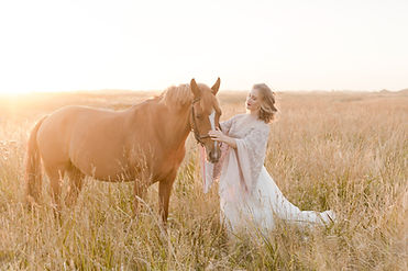 bride and horse at sunset
