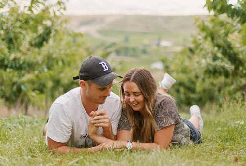 Cromwell engagement photos in a Cherry Orchard