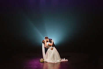 Bride n Groom kiss in theatre weddin