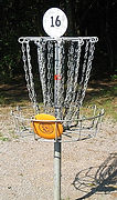 220px-Disc_golf_in_basket.JPG