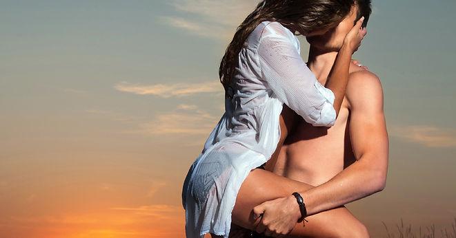 KissingLegHookedOnHisWaistWhiteShirt.jpg