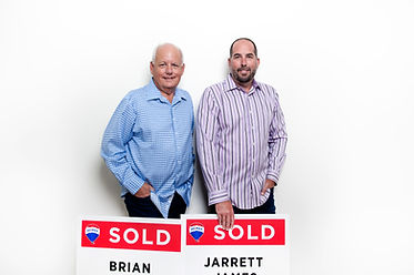 Fort Erie Realtors Brian and Jarrett holding sold signs