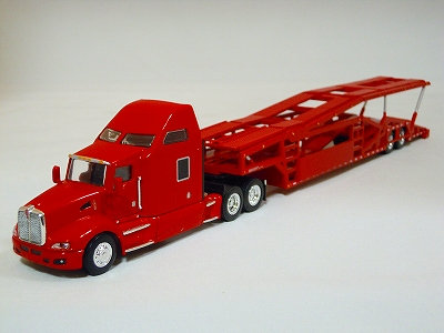 Red Kenworth T660 Tractor with Miller Industries Auto Rack Trailer