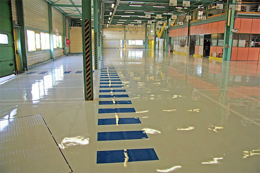 Revêtement sol en résine | Entrepôt transport et marquage au sol | 2G Bâtiment