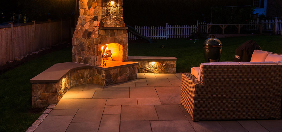 Indresano Corporation landscaping design, construction and maintenance – Evening fire by the outdoor stone hearth, fireplace