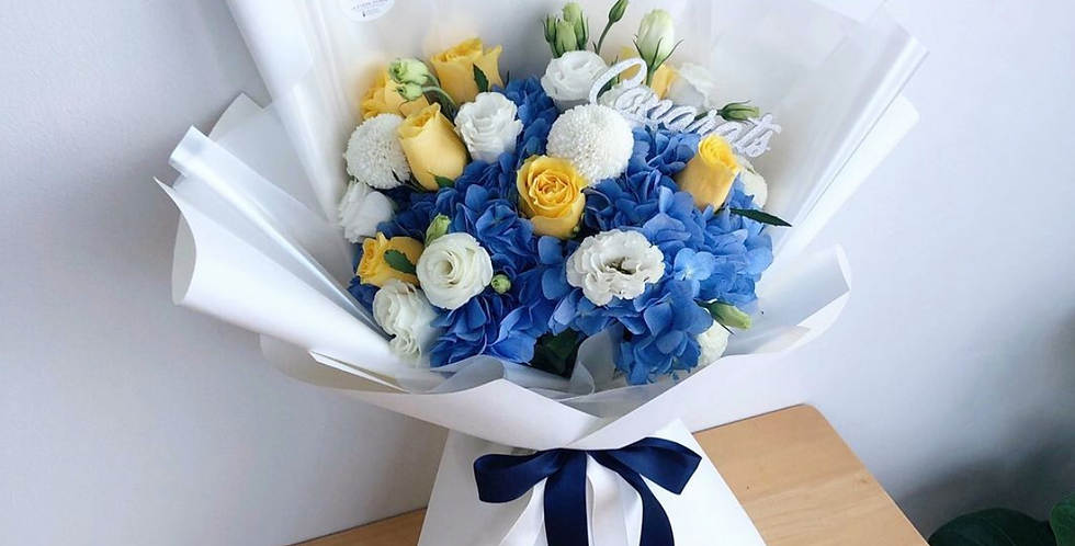 A Mix of Blue Hydrangeas with White & Yellow Tone Flowers