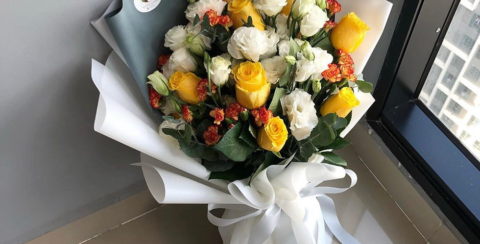 A Mix of Yellow / White / Orange Flower Bouquet