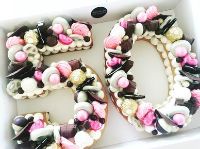 עוגת מספרים 50 ורוד