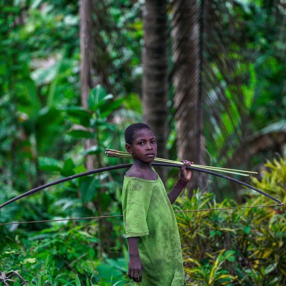 A child from the village of Mukwais carries his toy bow and arrows along the Sepik River - Sepik Province, Papua New Guinea