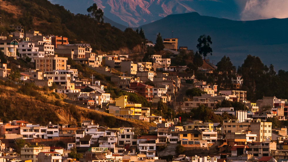 Volcan Cotopaxi towering above a neighborhood in Quito - Quito, Ecuador