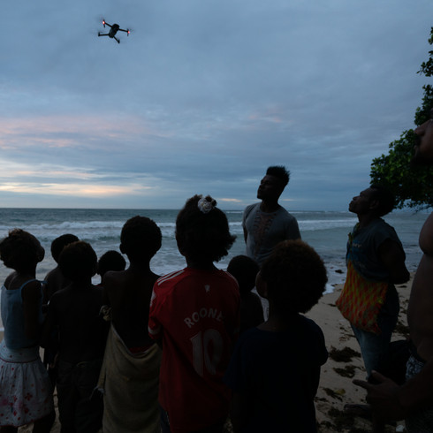 A group of children from the village of Lido mesmerized by my drone - Vanimo, Papua New Guinea