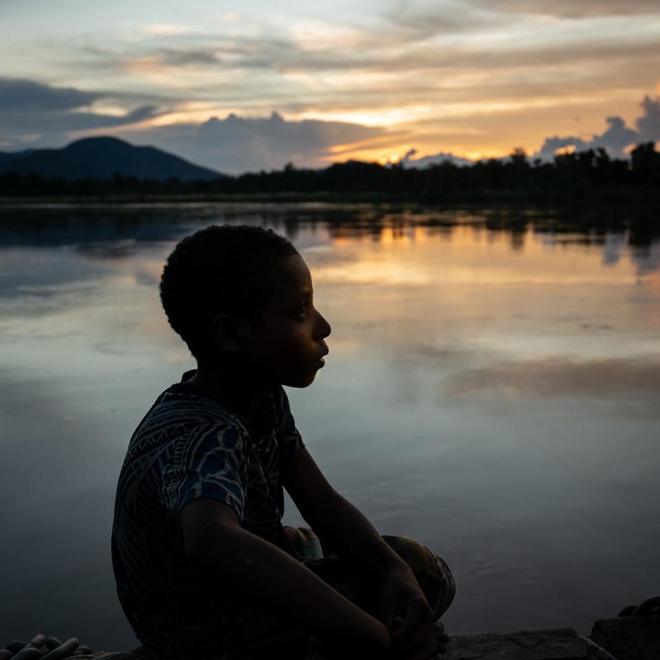 A child from the Elamory Village enjoying the sunset - Sepik Province, Papua New Guinea