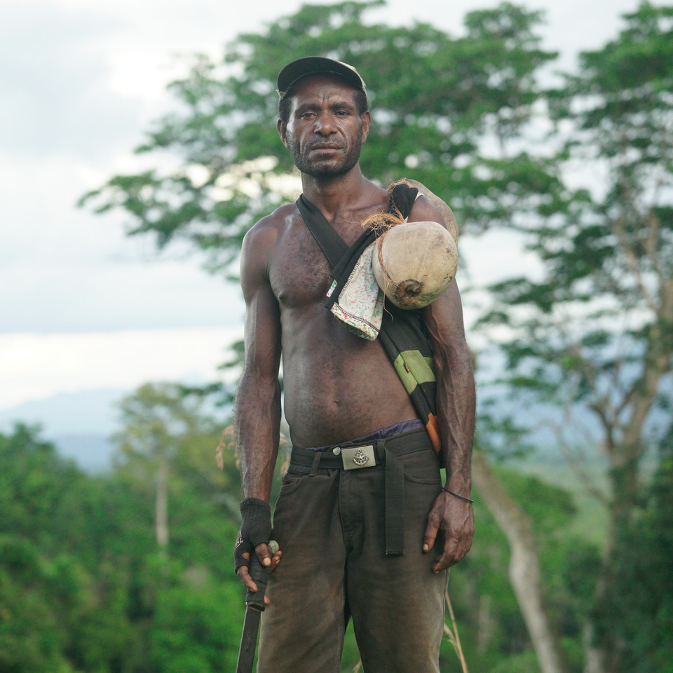 A man from the village of Dio returning from the bush - Green River, Papua New Guinea