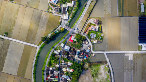 A neighborhood in between the flooded rice fields of Yilan City - Yilan, Taiwan