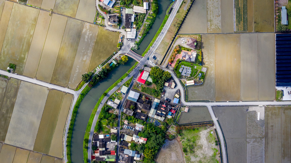 A neighborhood in between the flooded rice fields of Yilan City - Yilan, Taiwan