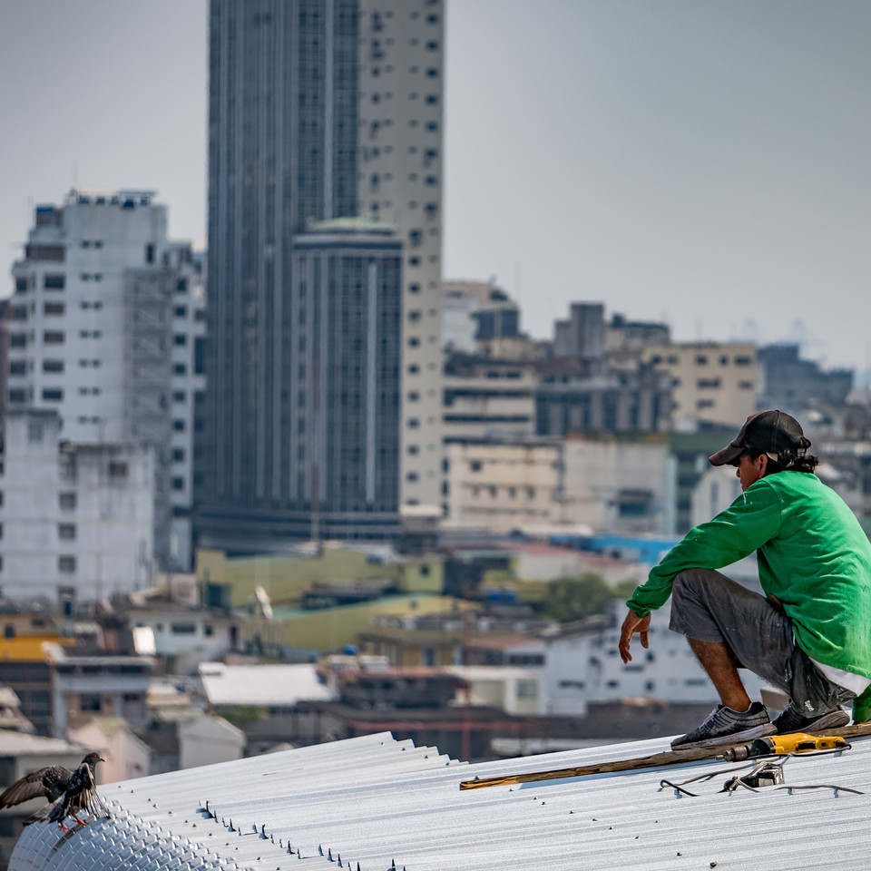 A construction worker takes a break on a rooftop - Guayaquil, Ecuador