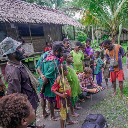 Villagers from the village of Mukwais encricle me as I fly my drone - Sepik Province, Papua New Guinea