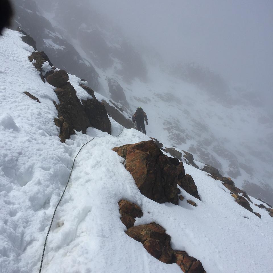 A friend and I crossing the snowy face of Illiniza Norte - Illiniza Ecological Reserve
