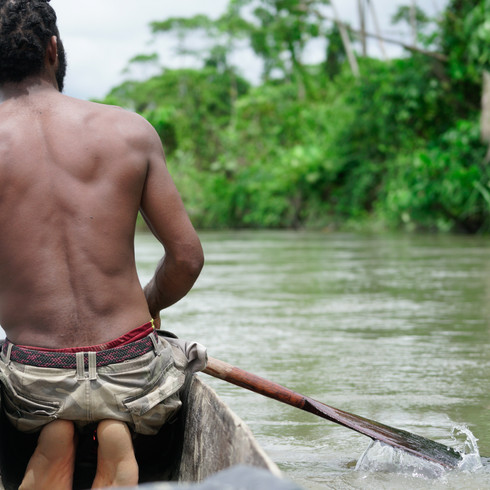 A man from Green River paddles on the Sepik - Sepik Province, Papua New Guinea