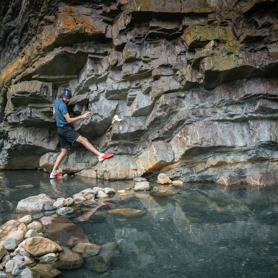 A friend playing on boulders above hot springs - Yilan County, Taiwan